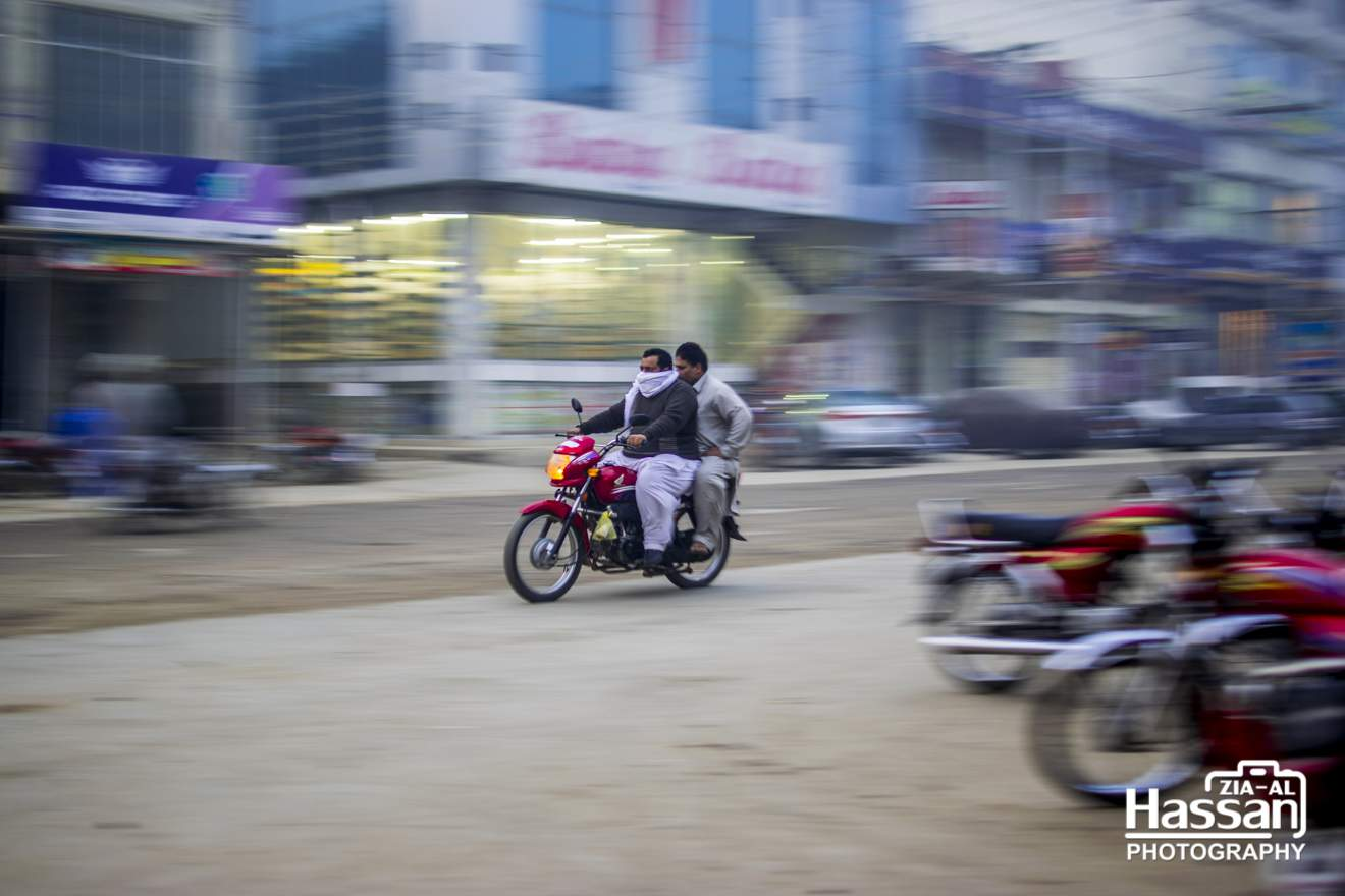 Panning Shot Of A Motorcycle On Road
